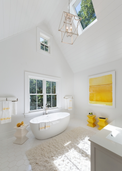 White and yellow bathroom with Marvin windows and skylight