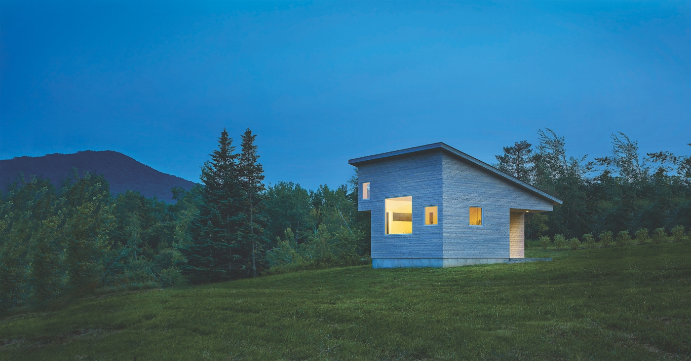 Micro house with light shining through Marvin Windows.