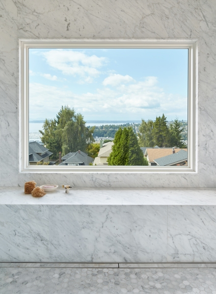 Marble bathroom with oversized Marvin picture window and spectacular view